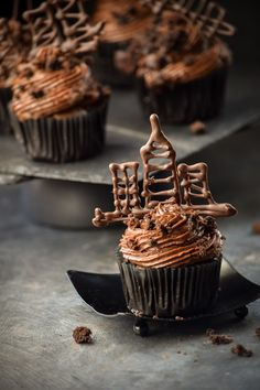 Brooklyn Blackout Cupcakes -- Chocolate Cupcakes filled with Chocolate Pudding and topped with Cupcake Crumbles and Melted Chocolate