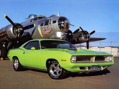 The 71' Plymouth Barracuda in one of its prime colors.. man the engine in this thing is amazing