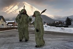 """Donning grotesque masks and wearing suits made from lichen gathered in the woods and sewn onto clothing by women, a father and son become """"Wild Ones"""" during a Pagan end-of-winter celebration known asSchleicherlaufen, held in the Tyrol of Austria since 1571."""