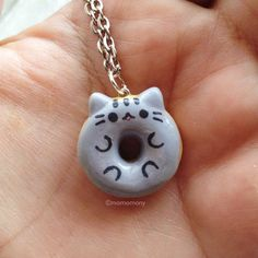Pusheen The Cat in donut form on a necklace! visit http://stitchme.gifts for more
