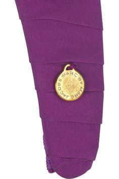 Violet twill wide headband with a plum crocodile-stamped velvet bow detail. Marc by Marc Jacobs headband has a designer-stamped gold-tone button on bow and a designer-embossed gold-tone tag at side.