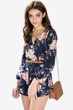 Let your style bloom into perfection with this trendy romper. It features a surplice neck, long sleeves, elasticized waist with braided brown belt. Blossom floral print. Finished leg openings. $32.50
