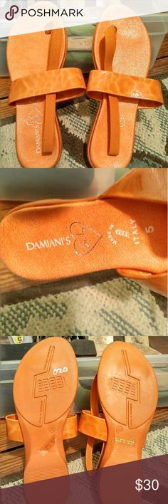 "NWOT DAMIANI'S TANGERINE SANDALS SIZE 5 NWOT DAMIANI'S TANGERINE SANDALS SIZE 5, made in Italy. LOVE LOVE LOVE their slogan (as seen in pic 4)... ""hand made with love, obviously in Italy"" lol. FABULOUS! These are FABULOUS sandals, they just aren't quite my style (mom bought them for me). I have tried them on, and I will say this, they are INCREDIBLY COMFORTABLE!  **open to REASONABLE OFFERS ONLY!** or bundle with other items from my closet ????????? Damiani's  Shoes Sandals"