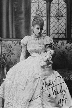Queen Mary with Princess Mary at her christening