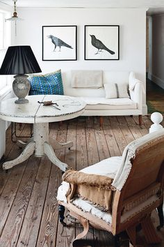 Rustic Wood Floors // Round Wooden Table // White Couch // At Home With John Derian // sfgirlbybay
