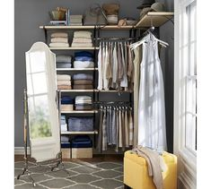 """This closet creates a beautiful backstage for your bed while creating all the privacy you need. Simply use a curtain to create separation and an """"official"""" closet is born. What's not to love in this Pottery Barn room? Coat Closet Organization, Closet Shelves, Closet Storage, Home Organization, Organizing Ideas, Organizing Solutions, Clothing Organization, Storage Solutions, Storage Room"""