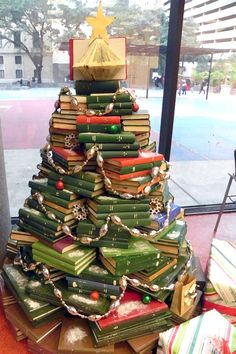 Gorgeous example of a book tree from the Houston Public Library Book Christmas Tree, Creative Christmas Trees, Book Tree, How To Make Christmas Tree, Xmas Tree, All Things Christmas, Christmas Holidays, Christmas Crafts, Christmas Decorations