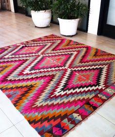 love the tribal print inspired rug idea