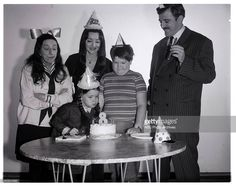 A rare behind the scenes shot of stars Carolyn Jones, John Astin, Ken Weatherwax and special guest Margaret Hamilton celebrating Lisa Loring's 8th birthday during filming of the 1966 THE ADDAMS FAMILY TV episode, Happy Birthday Grandma Frump!