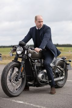 The Duke of Cambridge sits upon a Triumph Bobber motorcycle during a visit to the MIRA Technology Park in Nuneaton, Warwickshire Moto Guzzi, Guzzi Bobber, Guzzi V7, Bobber Motorcycle, Motorcycle Quotes, Motorcycle Style, Ducati Scrambler, Triumph Motorcycles, Indian Motorcycles