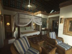 Temple Suite Bedroom w/Four-Poster Antique King size Bed opening to Patio & Pool