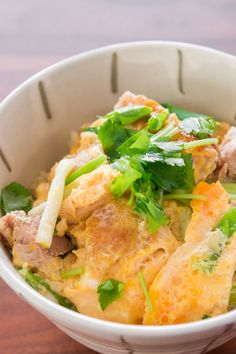 """Oyako donburi (親子丼), which literally means """"parent child bowl"""" is a popular chicken and egg rice bowl in Japan. It's a simple one bowl meal with flavorful chunks of chicken wrapped in a custardy blanket of eggs, all seasoned with a mild dashi broth that tickles down onto the steamy bed of rice below."""