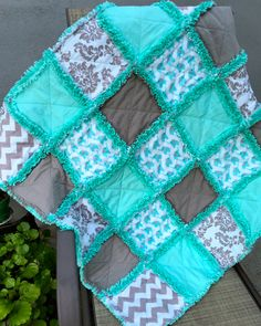 Ready to Ship  Here is a cute baby elephants rag quilt in turquoise and gray. It features Cloud 9 Organic Fanfare Flannel Elephants Blue, chevrons and