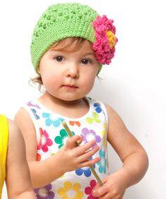You'll have to resist plucking up baby when she's adorned in this colorful tot topper. This adorable hat is a picture-perfect gift!