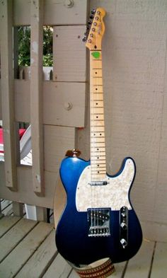 Blue American Fender Telecaster. This one was from Sam Ash on Sunset Blvd in Hollywood, CA. 2 weeks after we bought they moved down the block across from GTR Center.