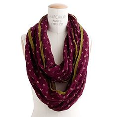 madewell circle scarf, comes in black with bright pink trim.