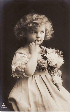 1910...Sweet Little Girl....Curly Hair....Flower Bouquet...Victorian...original vintage postcard. $8,99, via Etsy.