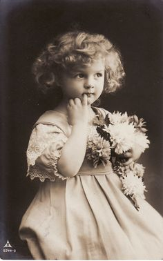 1910...Sweet Little Girl....Curly Hair....Flower Bouquet...Victorian...original vintage postcard. $8,99, via Etsy.