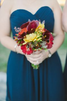 Blue bridesmaids + Red & Yellow Bouquet -- Pretty! See more on #SMP:   http://www.StyleMePretty.com/new-england-weddings/2014/04/01/salem-waterfront-wedding/ Zac Wolf Photography - zacxwolf.com