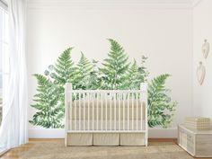 Painted Ferns behind a white crib on a white wall with large green leaves.