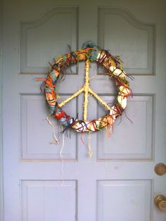 my own homemade peace wreath!! love it but it DOES block the peep hole, just a heads up!
