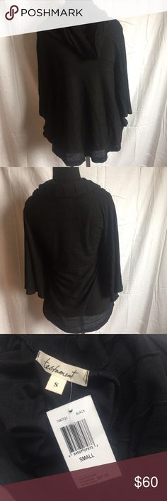 Revolve Testament black sweater w/ cowl neck sz S Revolve Testament black sweater w/ cowl neck size S. NWT. 100% Authentic. Reasonable offers are welcome. No trades. testament Sweaters Cowl & Turtlenecks