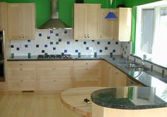 Fused Glass in the kitchen. Adagio glass accent tiles in backsplashes