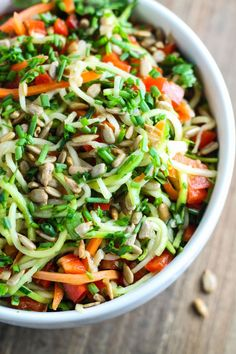 Fresh and colorful, this 10-minute Low Fodmap Asian Zoodle Salad is delish. Make this fast and flavorful salad recipe for a light lunch or serve with shrimp for a quick, gluten free supper.
