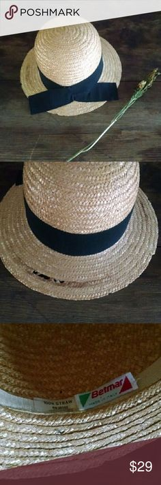 """Italian Straw Hat Vintage Betmar Tall Crown Straw hat with black ribbon trim   Made in Italy. By Betmar I like the cool tall crown, it's a nice shape.  See the pics as there is some *damage* in the weave in a section on the brim from age/wear.  It's an older hat . sold as is with imperfections. Still looks rad IMO.   Crown height approx 4.5"""" Brim 2.5""""  Flaw area 2""""  Interior circumference approx 22""""   Tags italian, bowler, laura Ashley, cloche, boho, straw vacation, summer, free people…"""