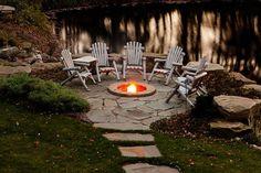 Lakeside patio idea; sunken fire pit, mowable  stone pavers.