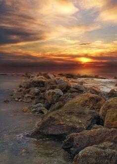 Sun sea stones.
