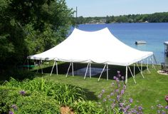 30 x 45 pole tent on lakefront - a beautiful view for any birthday, wedding, corporate event, or graduation. 844-TENT PRO