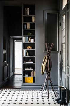 Grey hallway with built-in shelves