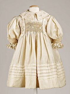 incredibly beautiful antique, American made, hand smocked silk child's dress ... c,1895, gift from the Brooklyn Museum's costume collection to the Metropolitan Museum of Art. Photo courtesy the Metropolitan Museum of Art costume collection