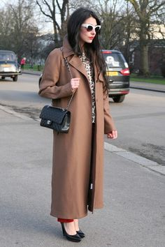 Toffee maxi coat, cheetah print, quilted bag refined elegance goes street.
