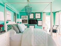 Majestic teal walls and a lavish canopy bed give the master bedroom a glamorous vibe with comfortable features.