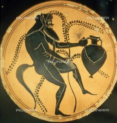 Title: Inside of a black figure Attic kylix with a depiction of a dancing Silenus holding a wine amphora, the work is housed at the Museo Etrusco of the Villa Julia, Date of photography:1985-1995, Credits: Alinari Archives, Florence, Reproduced with the permission of Ministero per i Beni e le Attività Culturali
