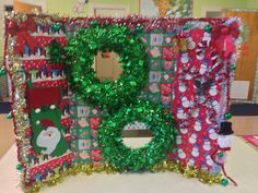 Photo booth for class parties! Cover a tri fold board (like the ones used for science projects) with different wrapping papers. Cut out two holes for faces to poke through. Hot glue wreaths over open holes. Hot glue different Christmas decorations on the board like tinsel, ornaments, streamers, etc. Be creative! This idea can be used for any party theme. Just change the decor.