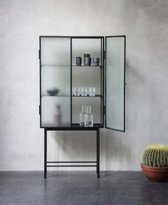 Haze is a freestanding cabinet crafted from powder-coated metal and textural armoured glass.