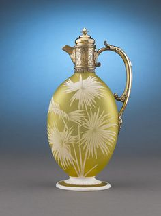 This splendidly carved cameo glass claret jug, crafted by the renowned Thomas Webb