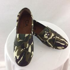 Camouflage Canvas Slip-ons Size 7 Dark Green camouflage print slip ons. Very comfortable. With rubber soles. Canvas Carrin Shoes Sneakers