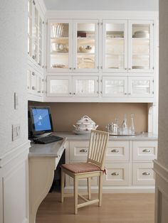 ADORE these cabinets - WANT!!! I love how this space is used as a home office but could just as easily be used for any other purpose without having to change or convert anything. A-MA-ZING!!!!
