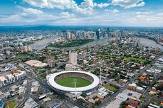 The Brisbane Cricket Grounds at the 'Gabba' in the foreground. The Brisbane River snaking around in the background. Brisbane River, Brisbane Cbd, Brisbane Queensland, Brisbane Australia, Things To Do In Brisbane, 100 Things To Do, Cricket World Cup, World Cities, Aerial Photography