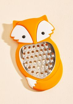 The Fox's Leyden Cheese Grater | Mod Retro Vintage Kitchen | ModCloth.com  This orange fox is happy to lend his belly to grate your parmesan, cheddar, or asiago! Just be warned that his silicone silhouette is such a pleasure to hold, you might not be able to stop shredding!