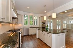 Wood floors, granite counters, whit cabinets