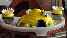 Bee hive cake. Use a giant cupcake pan from Wilton but only use the top part. Pour icing onto cake then hollow out entrance