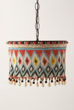 Anthropologie Kirdi Pendant Lamp, Large$1,298   These lamp covers are made using the same technique that the Kirdi women (Grasslands, northern Cameroon) use to make their apron/cache sexe.  These aprons are traditionally made from glass beads, cowrie shells and thread/string