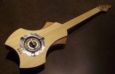 Bamboo One, an acoustic 3-string Slide Guitar $200