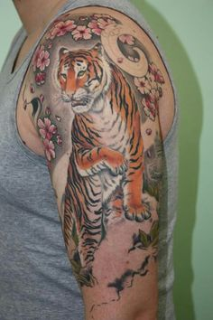 Tattoo tiger and cherry tree flowers