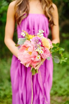 Bright bouquet for the boho #bridesmaid Photography: Tucker Images - www.tuckerimages.com  Read More: http://www.stylemepretty.com/2014/08/05/colorful-boho-diy-wedding/